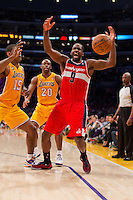 22 March 2013: Forward (9) Martell Webster of the Washington Wizards has the ball knocked out his hands by (15) Metta World Peace of the Los Angeles Lakers during the second half of the Wizards 103-100 victory over the Lakers at the STAPLES Center in Los Angeles, CA.