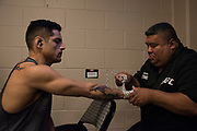 DALLAS, TX - MAY 13:  Gabriel Benitez has his hands wrapped before fighting Enrique Barzola during UFC 211 at the American Airlines Center on May 13, 2017 in Dallas, Texas. (Photo by Cooper Neill/Zuffa LLC/Zuffa LLC via Getty Images) *** Local Caption *** Gabriel Benitez