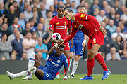 Liverpool defender Virgil van Dijk (4) gives a helping hand to Chelsea forward Tammy Abraham (9) during the Premier League match between Chelsea and Liverpool at Stamford Bridge, London, England on 22 September 2019.