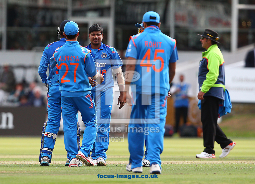 Karn Sharma ( C ) of India celebrates taking the wicket of James Harris of Middlesex County Cricket Club during the Tour Match at Lord's, London<br /> Picture by Paul Terry/Focus Images Ltd +44 7545 642257<br /> 22/08/2014