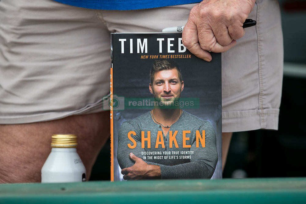 July 7, 2017 - Jupiter, Florida, U.S. - Fans wait patiently for an autograph from Tim Tebow before game against the Jupiter Hammerheads at Roger Dean Stadium in Jupiter, Florida on July 7, 2017. (Credit Image: © Allen Eyestone/The Palm Beach Post via ZUMA Wire)