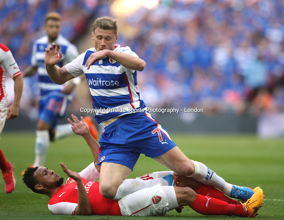 18 April 2015  FA Cup semi-final - Arsenal v Reading;  Francis Coquelin of Arsenal slide tackles Pavel Pogrebnyak.<br /> Photo: Mark Leech