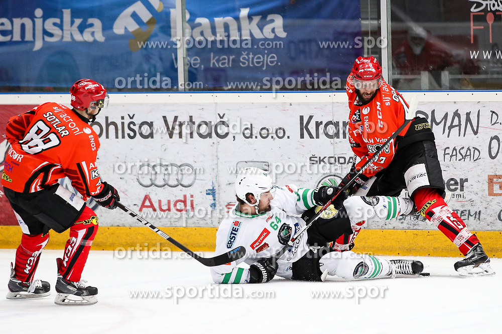 Raphael Bussieres of Olimpija and Martin Oraze of Jesenice during ice hockey match between HDD SIJ Acroni Jesenice and HDD Olimpija Ljubljana in Final of Slovenian League 2016/17, on April 9, 2017 in Podmezaklja, Jesenice, Slovenia. Photo by Matic Klansek Velej / Sportida