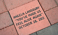 NEW HOPE, PA -  OCTOBER 28: Actress Angela Lansbury is presented with a commemorative brick to be installed in the walkway October 28, 2013 at the Bucks County Playhouse in New Hope, Pennsylvania.  Lansbury,  five-time Tony Award winning actress is the first inductee of the Bucks County Playhouse's Hall of Fame.(Photo by William Thomas Cain/Cain Images)