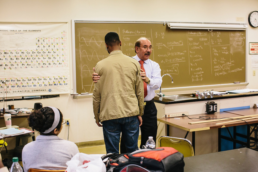 Dr. Daryao Khatri, a professor at University of Washington DC, uses student Solomon Lynch to demonstrate rotation during a physics class on Thursday, April 9, 2014. Dr. Khatri uses a variety of different methods to teach physics to students, including forgoing the standard textbook and instead giving students binders full of his lessons.