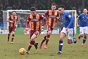 Bradford City forward Shay McCartan (14)  and Oldham Athletic Midfielder, Kean Bryan (40) uring the EFL Sky Bet League 1 match between Oldham Athletic and Bradford City at Boundary Park, Oldham, England on 3 February 2018. Picture by Mark Pollitt.