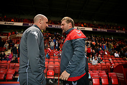 Wigan Athletic manager Paul Cook and Charlton Athletic manager Karl Robinson