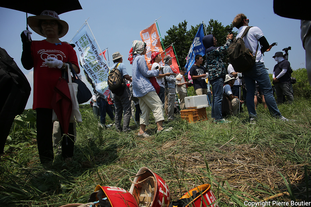 July 9,2017_Tokyo,Chiba   farmers and revolutionnary leagues fighting against the expropriation of their land by Narita airport company who want to expand the land of airport . 50 years after the first actions of resistance, and a long  struggle where there were more than 6500 wounded and 3300 arrests and two deaths in confrontations with the police anti Riots, groups from the new left, such as the Zengakuren, the farmers' league, the communist league, anarchist groups are gathering on the plots of Sir Takao Ito who continues to fight against his expropriation. Pierre Boutie