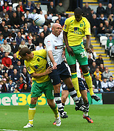 Preston - Saturday September 18th, 2010: Grant Holt and Leon Barnett of Norwich and Wayne Brown of Preston in action during the Npower Championship match at Deepdale, Preston. (Pic by Paul Chesterton/Focus Images)