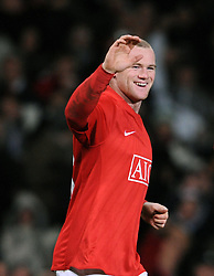 Wayne Rooney of Manchester United celebrates after equalizing at 2-2