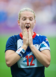 COVENTRY, ENGLAND - Friday, August 3, 2012: Great Britain's Kim Little lines-up for the national anthems during the Women's Football Quarter-Final match between Great Britain and Canada, on Day 7 of the London 2012 Olympic Games at the Rioch Arena. Canada won 2-0. (Photo by David Rawcliffe/Propaganda)