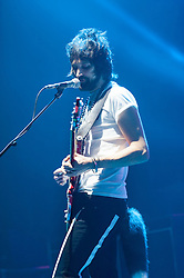 © Licensed to London News Pictures. 01/12/2014. London, UK.   Kasabian performing live at Brixton Academy for the first of five consecutive nights at the venue.   In this picture - Sergio Pizzorno.  Kasabian consists of members Tom Meighan (lead vocals) Sergio Pizzorno (guitar, backing vocals), Chris Edwards (bass), Ian Matthews (drums).  Photo credit : Richard Isaac/LNP