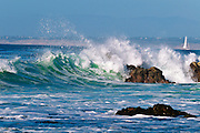 Crashing wave and sailboat, Pacific Grove, California USA