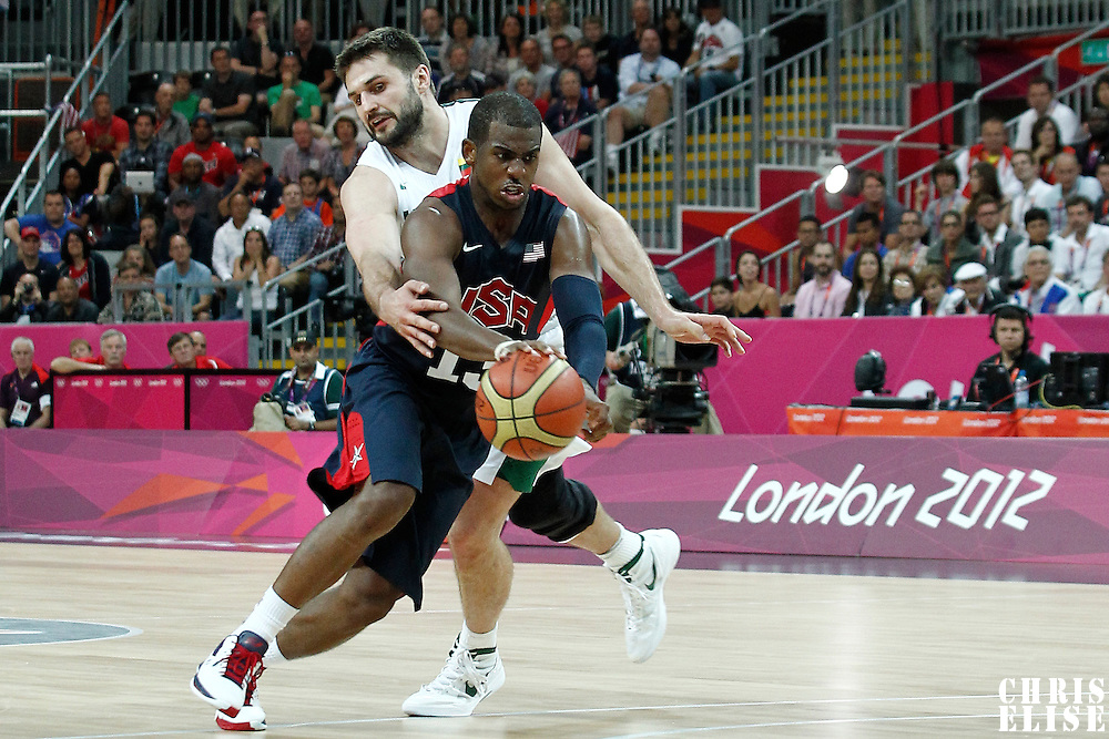 04 August 2012: USA Chris Paul is fouled by Lithuania Linas Kleiza during 99-94 Team USA victory over Team Lithuania, during the men's basketball preliminary, at the Basketball Arena, in London, Great Britain.
