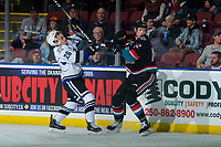 KELOWNA, CANADA - OCTOBER 5:  Tyler Lees #26 of the Victoria Royals is checked by Braydyn Chizen #22 of the Kelowna Rockets during first period on October 5, 2018 at Prospera Place in Kelowna, British Columbia, Canada.  (Photo by Marissa Baecker/Shoot the Breeze)  *** Local Caption ***