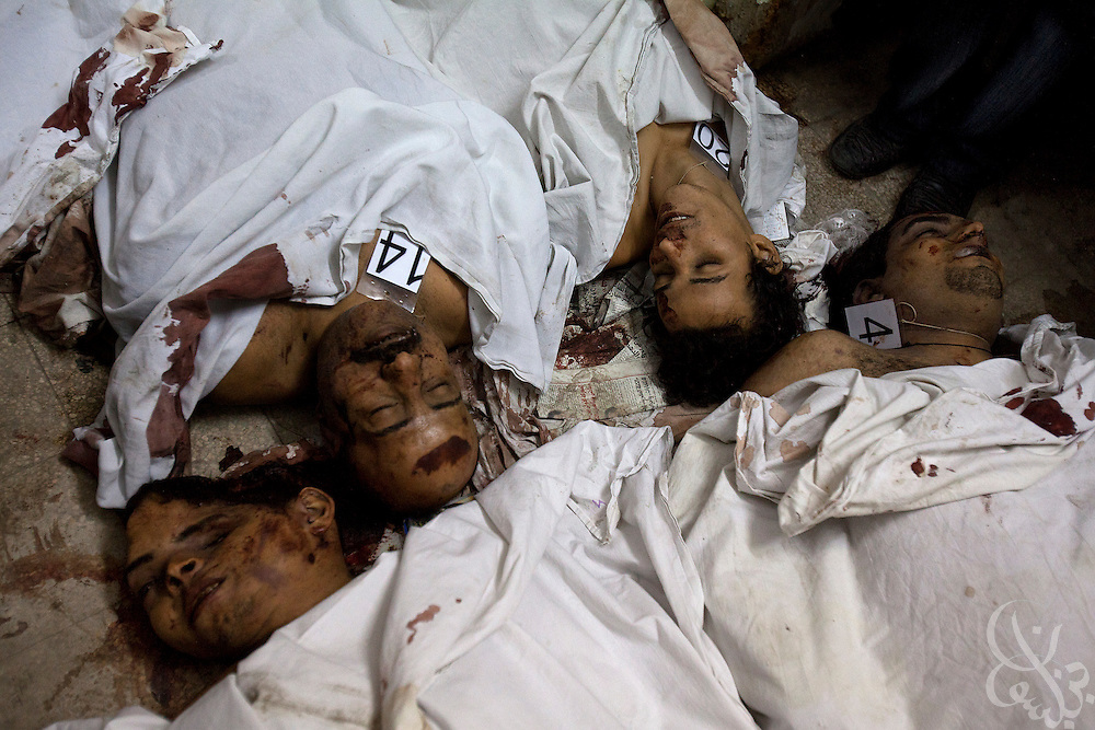 The bodies of Egyptian Coptic Christians lie on the floor of a morgue October 10, 20011 at the Coptic Hospital in Cairo, Egypt. At least 26 people, mostly Christian,  were killed during sectarian clashes that saw the worst violence since the Revolution that toppled former Egyptian president Hosni Mubarak earlier this year. Egyptian Coptic Christians make up about 10% of Egypt's 80 million population and periodically violence flares between the Christian minority and the majority Muslim population. (Photo by Scott Nelson