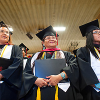 121213       Brian Leddy<br /> Navajo Technical University students Brenda Martinez, Anita Mae Pouncy and Valeria Yazzie smile after receiving their degrees during graduation ceremonies Friday in Chinle. The graduation was the first for the school as a university.