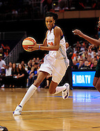 Sep 17 2011; Phoenix, AZ, USA; Phoenix Mercury guard DeWanna Bonner (24) handles the ball on the court while playing against the Seattle Storm during the first half at the US Airways Center.  The Mercury defeated the Storm 92 - 83. Mandatory Credit: Jennifer Stewart-US PRESSWIRE