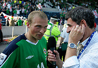 Photo: Andrew Unwin.<br />Northern Ireland v Azerbaijan. FIFA World Cup Qualifying match. 03/09/2005.<br />Northern Ireland's Warren Feeney (L) talks to the media after the game.