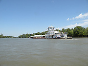 A tugboat pushing a barge along the McLellan-Kerr Arkansas River Navigation System in eastern Oklahoma