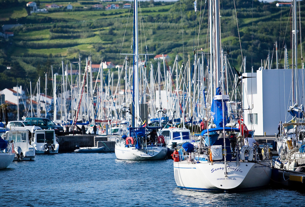 Yachts are packed into the harbor of Horta on the island of Faial. One of of the Azores,  a group of islands in the Atlantic that are a part of Portugal and the European Union. The Azores are a popular stopover with sailing boats crossing the Atlantic in the Spring.