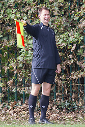 © Licensed to London News Pictures . 28/09/2014 . Birmingham , UK . Health Secretary JEREMY HUNT serves as linesman during the match . Conservative Party vs Journalists football match at a Birmingham University football pitch , at the start of the conference . The 2014 Conservative Party Conference in Birmingham . Photo credit : Joel Goodman/LNP