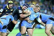 Hurricanes Blade Thomson tackles Force's Chris Heiberg during the Western Force and Hurricanes game, Super Rugby, NIB Stadium, PERTH, Western Australia. Friday, 27th February, 2015. Photo: Travis Hayto / photosport.co.nz