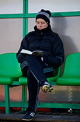 ZENICA, BOSNIA AND HERZEGOVINA - Tuesday, November 28, 2017: Wales' manager Jayne Ludlow reads a book on the bench before the FIFA Women's World Cup 2019 Qualifying Round Group 1 match between Bosnia and Herzegovina and Wales at the FF BH Football Training Centre. (Pic by David Rawcliffe/Propaganda)