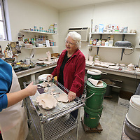 Sandra White, left, and Lucille Stone discuss glaze colors for a bowl being finished by the Salvation Army Women's Auxillary.