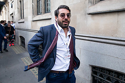 © Licensed to London News Pictures. 29/03/2019. Right-wing political activist Raheem Kassam leaves with Nigel Farage MEP (not pictured) after Farage spoke on stage at a Leave Means Leave demonstration in Westminster on the day that Britain was originally due to leave the European Union. MPs today rejected Theresa May's withdrawal deal for the third time. Photo credit : Tom Nicholson/LNP