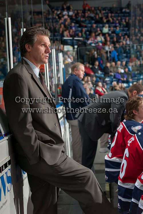 KELOWNA, CANADA - MARCH 8: Jim Hiller, head coach of the Tri-City Americans stands on the bench against the Kelowna Rockets on March 8, 2014 at Prospera Place in Kelowna, British Columbia, Canada.   (Photo by Marissa Baecker/Getty Images)  *** Local Caption *** Jim Hiller;