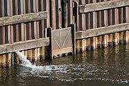 An urban factory in the city of Chicago, IL, emits waste water into the Chicago River.