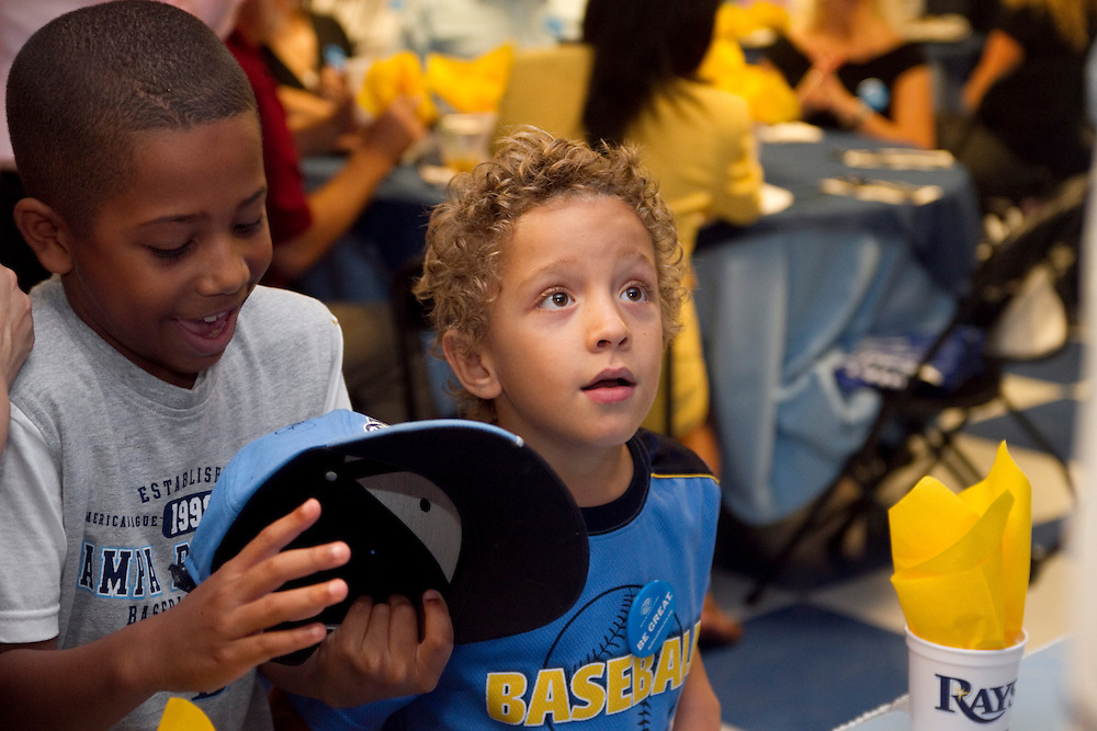 ADayWithTheRaysBoys&GirlsClub..Caption:(Friday 08/13/2010 Pinellas Park)Daniel Peralta, 8, admires his fresh Sean Rodriguez autograph on his hat as Berenger Hickey, 6, stares at the Tampa Bay Rays secondbaseman in amazement during the Boys & Girls Clubs of The Suncoast event A Day With The Rays, held at the Boys & Girls Club of Pinellas Park...Summary:Boys & Girls Clubs of The Suncoast event A Day With The Rays..Photo by James Branaman