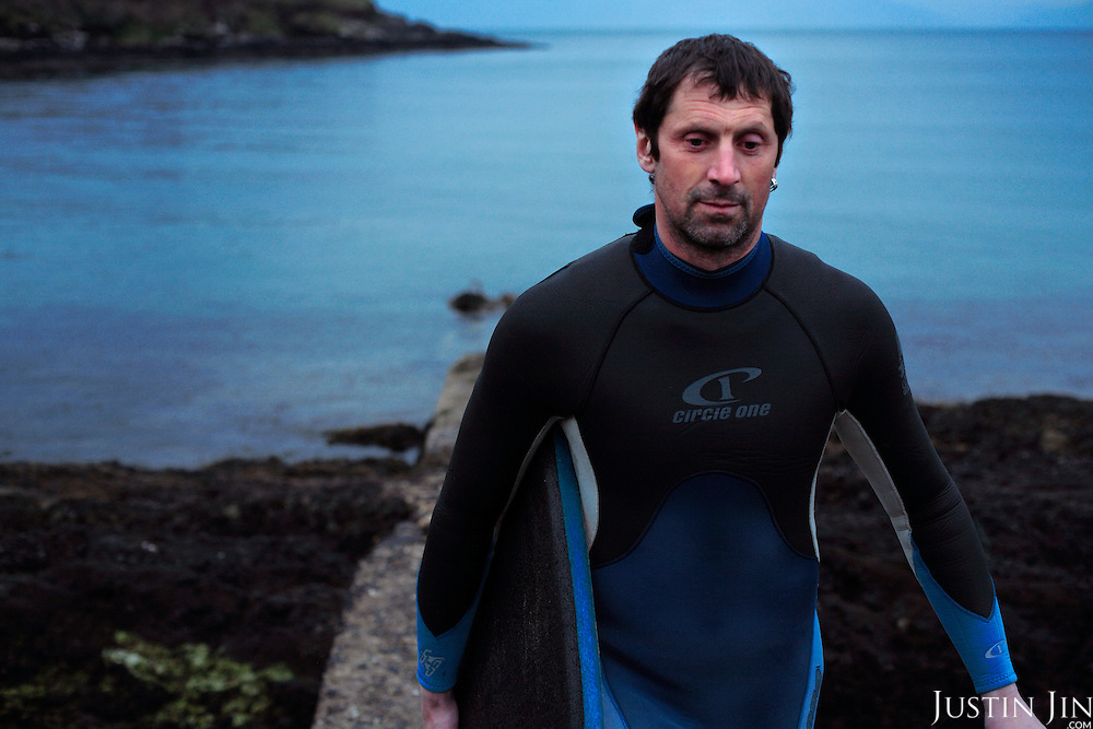 Nick Massett swims in Dingle harbour, County Kerry, on the west coast of Ireland, home of the famed dolphin Fungi..In 1984, the lone dolphin was observed escorting the fishing boats. The fishermen named him Fungi. Within months, he had become such a fixture that local officials declared him a permanent resident. .For more than 20 years, Fungi has stayed in the harbour and befriending humans, becoming one of Ireland's top attractions. England-born Massett and his family now live in Dingle has been swimming with the dolphin for years. .Every summer, Dingle town?s 3,000 inhabitants are overrun by tourists, who have come to see Fungi on boat trips..Fungi, a male bottlenose, is around 30 years old. He weighs about 250 kilos and is about four metres in length. .