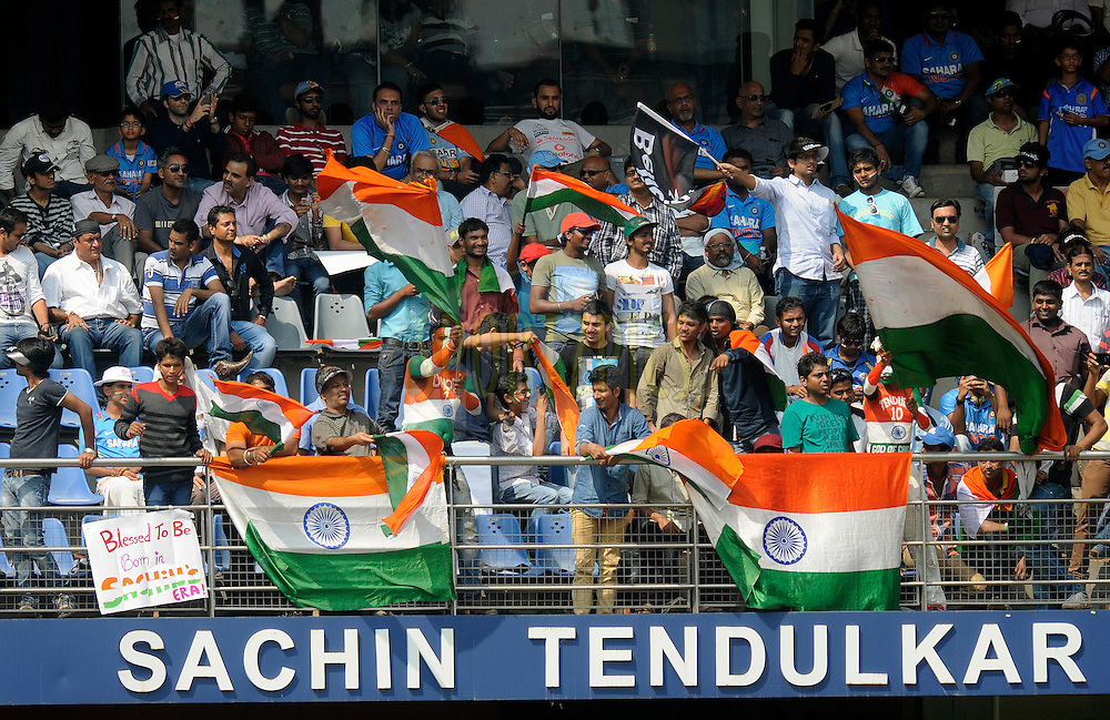 Spectators at Sachin Tendulkar stand during day two of the second Star Sports test match between India and The West Indies held at The Wankhede Stadium in Mumbai, India on the 15th November 2013<br /> <br /> This test match is the 200th test match for Sachin Tendulkar and his last for India.  After a career spanning more than 24yrs Sachin is retiring from cricket and this test match is his last appearance on the field of play.<br /> <br /> <br /> Photo by: Pal PIllai - BCCI - SPORTZPICS<br /> <br /> Use of this image is subject to the terms and conditions as outlined by the BCCI. These terms can be found by following this link:<br /> <br /> http://sportzpics.photoshelter.com/gallery/BCCI-Image-Terms/G0000ahUVIIEBQ84/C0000whs75.ajndY