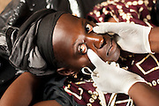 Nurse Maba N'Djim examines Awa Diarra, 26, 3 mo. pregnant, during a prenatal consultation in the village of Banankoro, Mali on Saturday August 28, 2010..