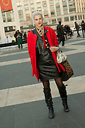 A woman in red and black outside the fashion show.
