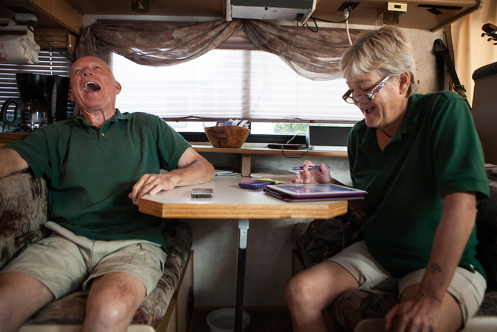 Chuck and Barb Stout do their morning trivia routine in their RV before reporting to work a concession stand at spring training in Tempe, Arizona.