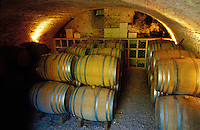 Barrels of aging Chablis in the cellars of Domaine Laroche, in Chablis, Burgundy, France