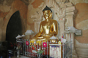 Myanmar Bagan Pagoda temple golden statue of a sitting Buddha