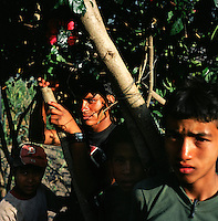 Two members of the Maoist rebels, also know as the PLA or People?s Liberation Army, along with two local boys in a remote part of western Nepal controlled by Maoist rebels. (Photo/Scott Dalton)