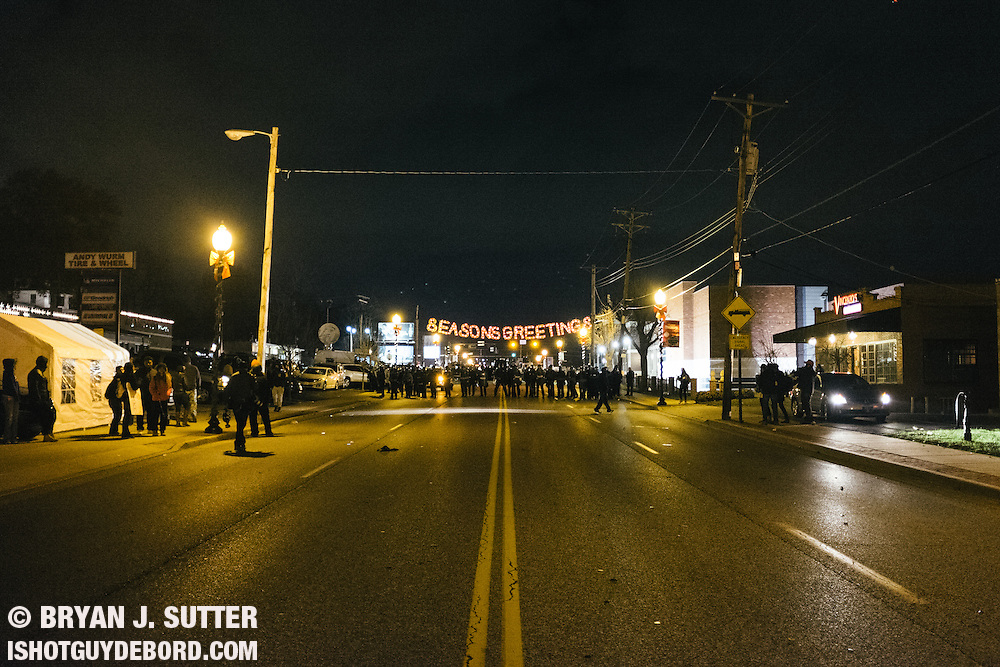 The scene outside the Ferguson police department on the evening of November 24th, 2014 after it was announced that officer Darren Wilson would not be indicted for the death of Mike Brown. This photo would later be used for the cover on the December 11th issue of the Riverfront Times. Fujifilm X100s.