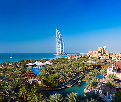 View of luxury resort hotels at  Madinat Jumeirah and Burj al Arab hotel to rear in Dubai in United Arab Emirates