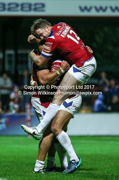 Picture by Alex Whitehead/SWpix.com - 10/08/2017 - Rugby League - Betfred Super League - Wakefield Trinity v Leeds Rhinos - Beaumont Legal Stadium, Wakefield, England - Wakefield's Bill Tupou celebrates his try with Tinirau Arona and Danny Kirmond.