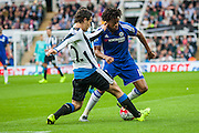 Newcastle United Daryl Janmaat makes a great tackle on Chelsea FC Loic Remy during the Barclays Premier League match between Newcastle United and Chelsea at St. James's Park, Newcastle, England on 26 September 2015. Photo by Craig McAllister.