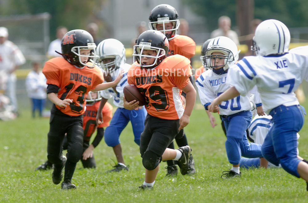 Middletown, NY - A Marlboro player carries the ball against Middletown in an Orange County Youth Football League game at Watts Park  on  Sept. 9, 2007.