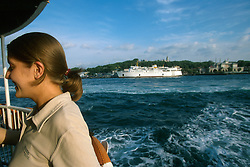 TURKEY ISTANBUL JUL02 - A female passenger enjoys the ride on one of Istanbuls many ferries across the Bosphorus...jre/Photo by Jiri Rezac..© Jiri Rezac 2002..Contact: +44 (0) 7050 110 417.Mobile:   +44 (0) 7801 337 683.Office:    +44 (0) 20 8968 9635..Email:     jiri@jirirezac.com.Web:     www.jirirezac.com