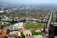 Jul 21, 2003; Beverly Hills, California, USA; Beverly Hills, home to some of America's most exclusive neighborhoods, collects hundreds of thousands of dollars per year in royalties from the oil wells disguised on the high school campus that have been drilling since 1906. Enviornmental activists ED MASRY and ERIN BROCKOVICH are fighting a nasty legal battle defending Beverly Hills High School Alumni who believe they contracted cancer from toxic chemicals released during oil driling.  Overall view of school, baseball & football fields, tennis courts, track and surrounding areas looking east from Century City towers.  <br />