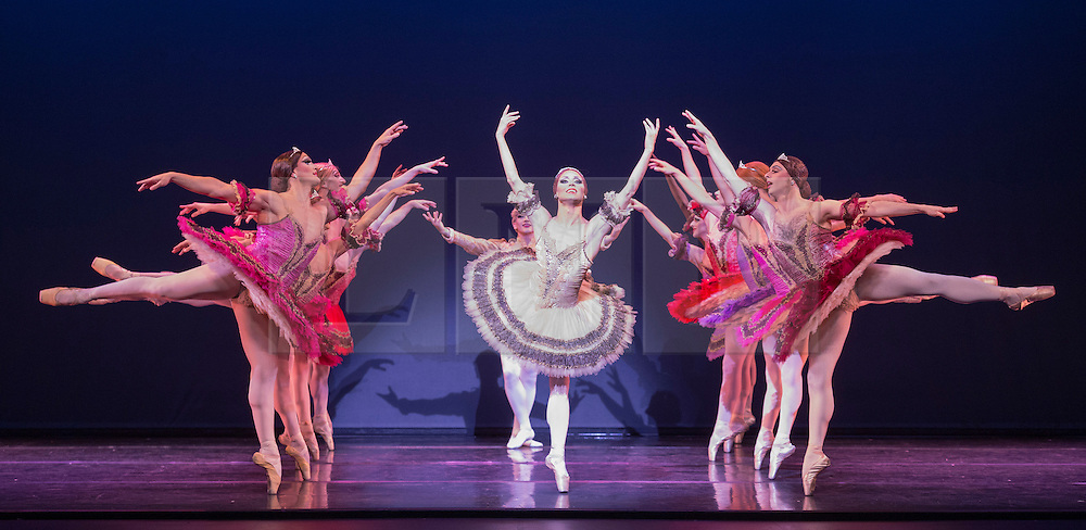 © Licensed to London News Pictures. 16/09/2015. London, UK. Programme One - Paquita with soloists Yakaterina Verbosovich (Chase Johnsey) as Ballerina and Sergey Legupski (Giovanni Goffredo) as Cavalier. Photocall for Les Ballets Trockadero de Monte Carlo at the Peacock Theatre. The all-male dance troupe, The Trocks, presents two different mixed bills at the Peacock Theatre from 15 to 20 September 2015. Photo credit: Bettina Strenske/LNP