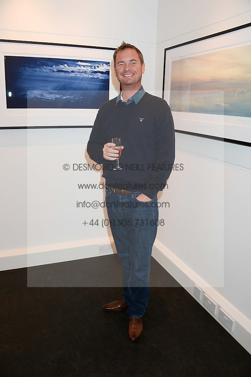 Singer TONY MORTIMER best known as a member of the boy band East 17 at a private view of Photographs by Julian Lennon held at The Little Black Gallery, 13A Park Walk, London SW10 on 17th September 2013.